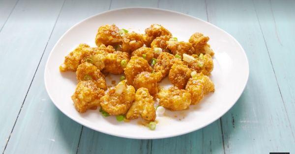 photo shows honey garlic coated cauliflower on a plate