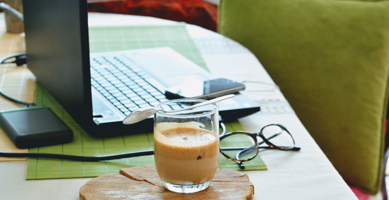 photo of a laptop and coffee on a desk