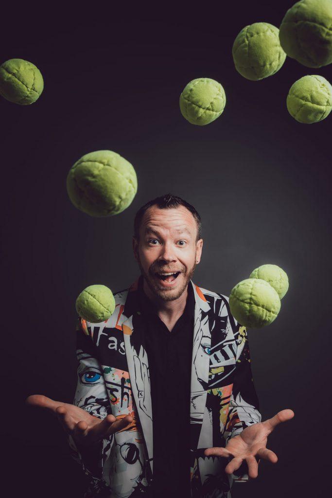 james bustar throws tennis balls in the air