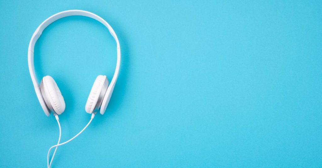 photo of white headphones on light blue background